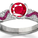 Ruby Rings for Sale - A marquise is set as a grand horizontal in a Fred Leighton pave-set diamond ring