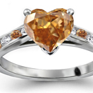 A round brilliant sits in a collet on top of a stylish diamond split-shank ring by H. Stern
