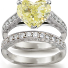 Two trillion side stones attend to a princess in a confident H. Stern ring