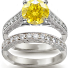 Round diamonds surround a marquise in a charming Smithwick-Dillion ring