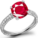 Wholesale Ruby Rings - Round diamonds surround a marquise in a charming Smithwick-Dillion ring