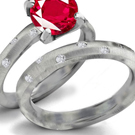 3 Stone Ruby Ring with Diamonds